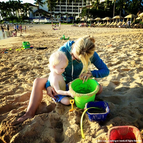 My friend Kim-Marie (The Luxury Travel Mom) plays in the sand with TY.