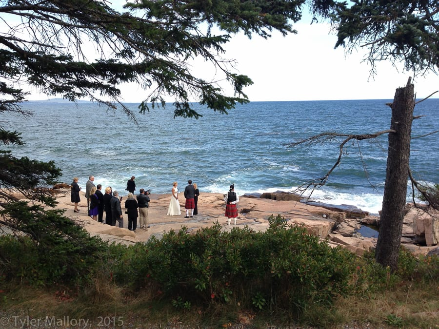 A bride and groom exchanging vows on the rocky shores of Acadia National Park