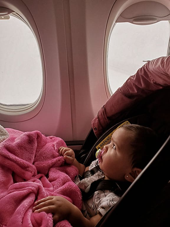 baby carseat on a plane
